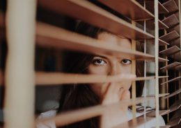 image-woman-behind-blinds