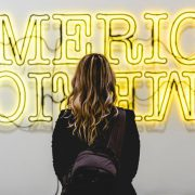 image-woman-facing-America-sign